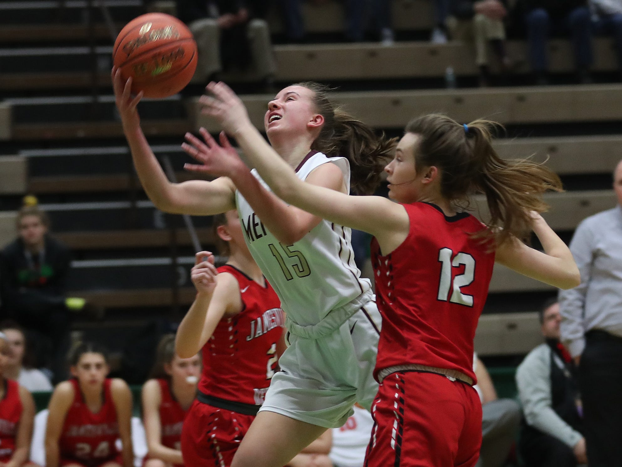 Pittsford Mendon's Danielle Strauf (15) drives to the basket against Jamesville-DeWitt's Sydney Baker (2) during the girls Class A state semifinal at Hudson Valley Community College in Troy March 16, 2019.
