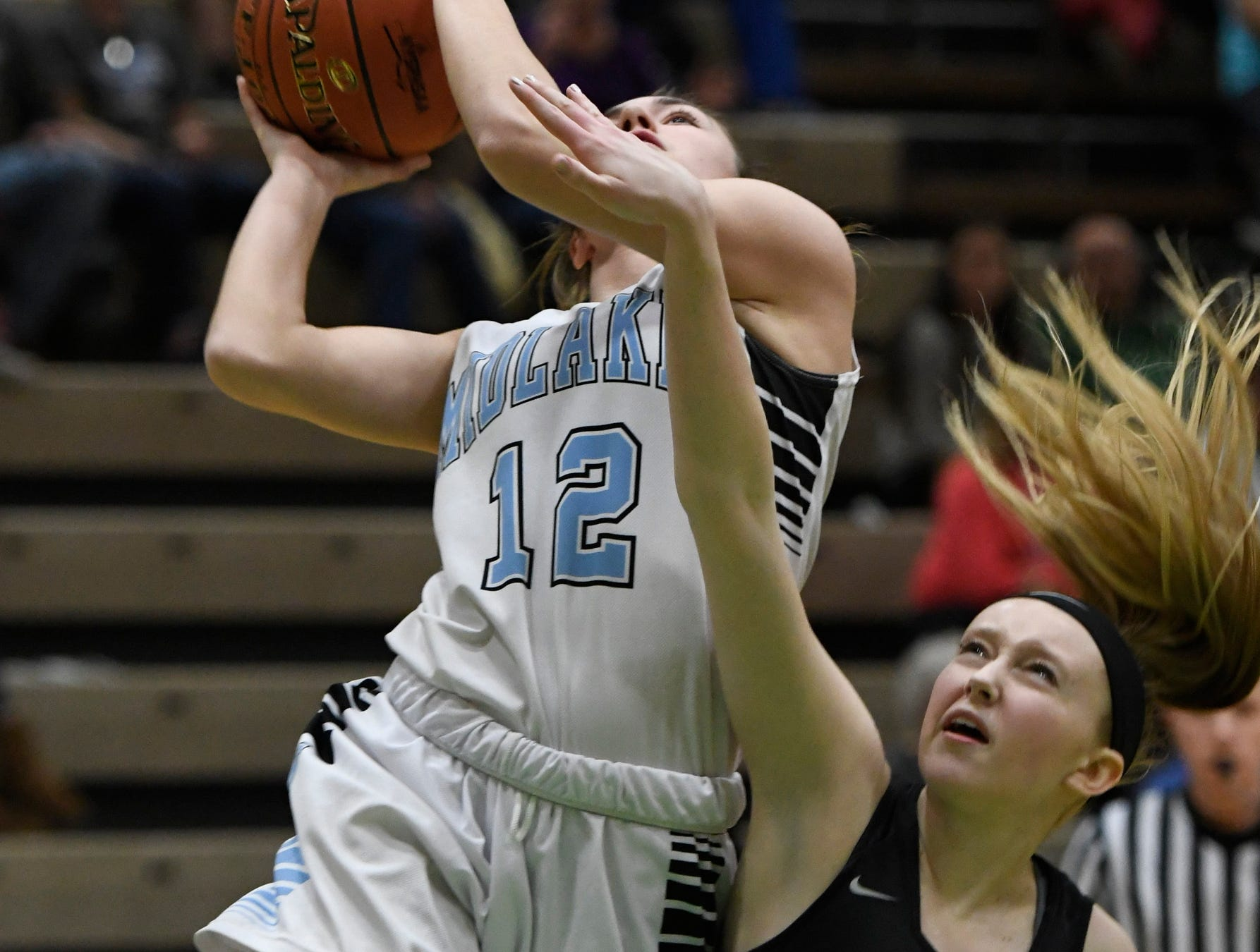 Canton's Sarah Sieminski attempts to stop a jump shot by Midlakes' Alaina Forbes during its Class B State Semifinal at Hudson Valley Community College in Troy, N.Y. on Friday, Mar. 15, 2019.