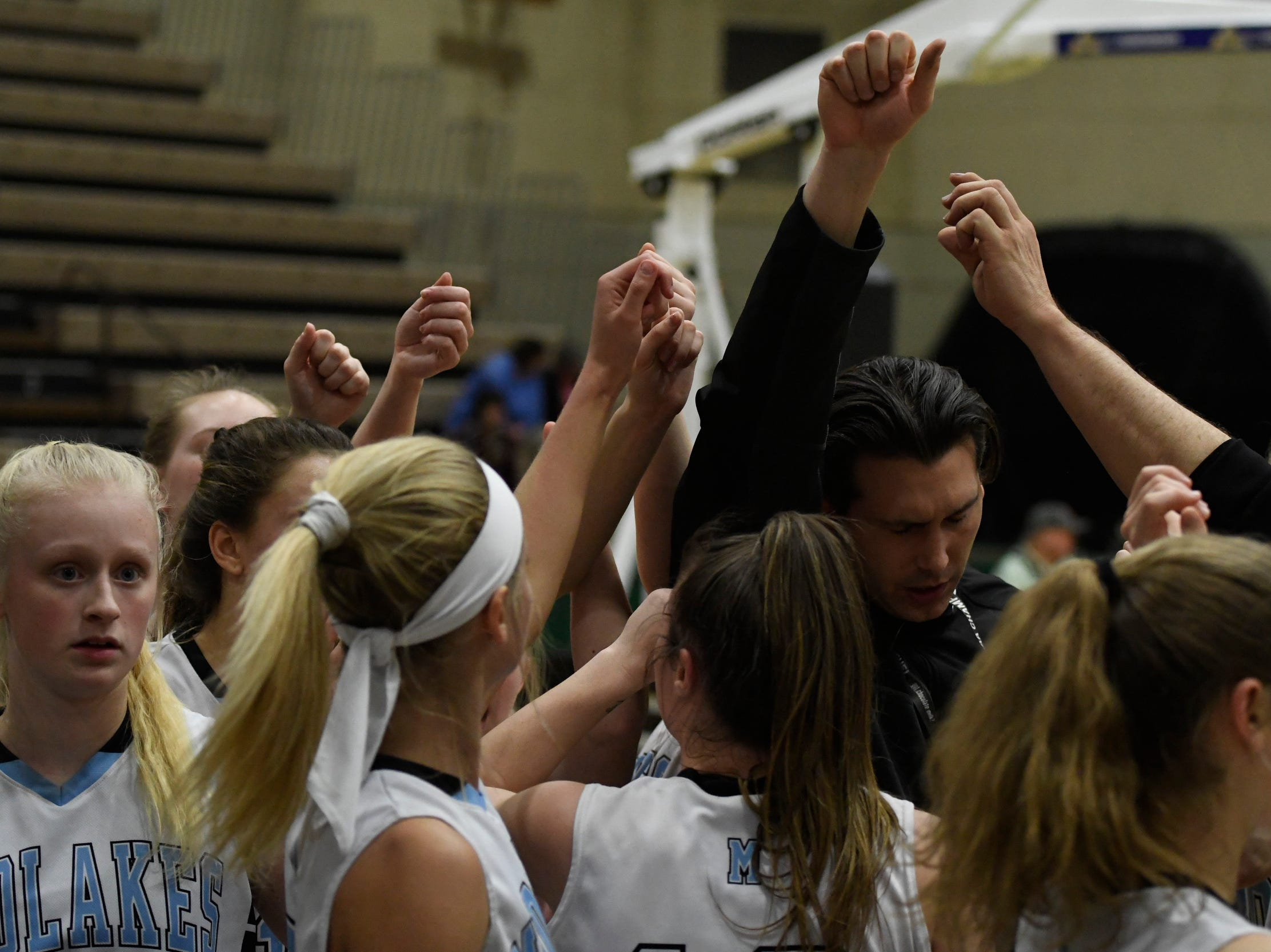 Midlakes girls basketball head coach Nate Rich, center, rallies his players between the third and fourth quarters of their Class B State Semifinal against Canton at Hudson Valley Community College in Troy, N.Y. on Friday, Mar. 15, 2019.