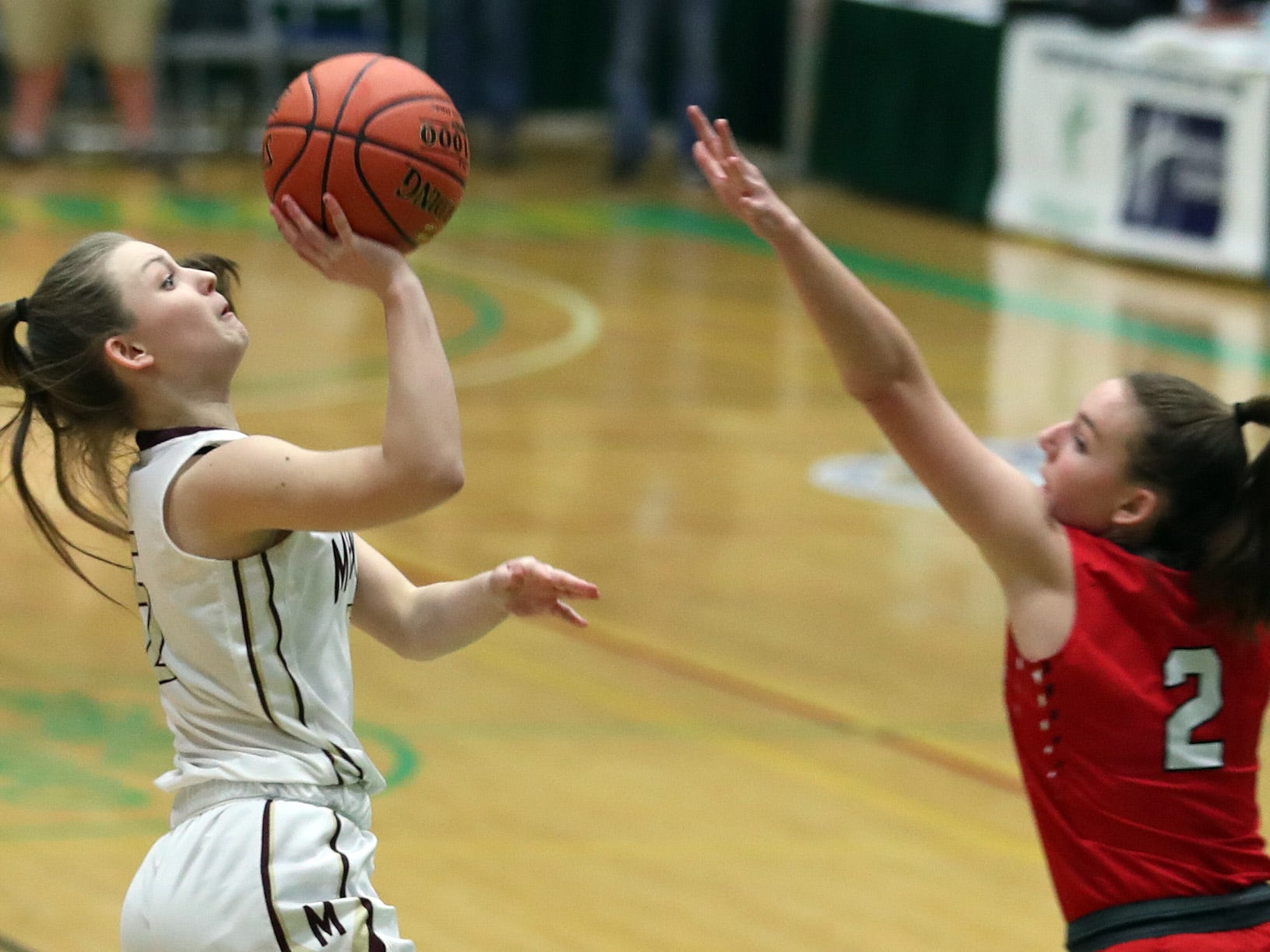 Mendon's Courtney Naugle (5) puts up a shot in front of Jamesville-DeWitt's Sydney Baker (2) during the girls Class A state semifinal at Hudson Valley Community College in Troy March 16, 2019.