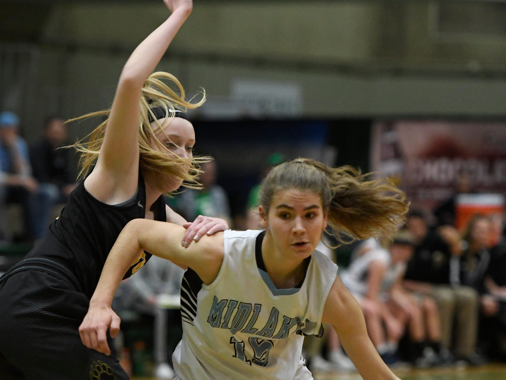 Midlakes's Cara Walker dribbles the ball past Canton's Sarah Sieminski during their Class B State Semifinal at Hudson Valley Community College in Troy, N.Y. on Friday, Mar. 15, 2019.