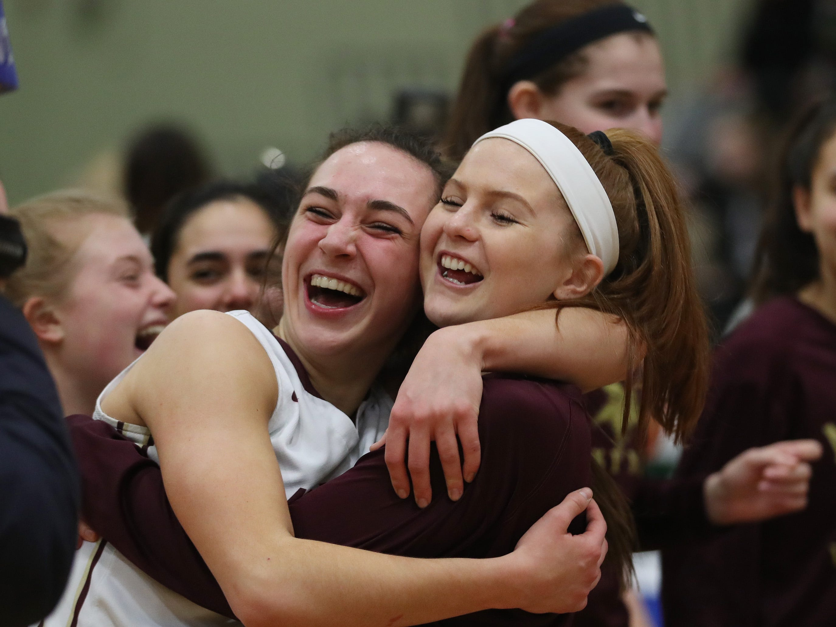Pittsford Mendon players celebrate their victory over  Jamesville-DeWitt in the girls Class A state semifinal at Hudson Valley Community College in Troy March 16, 2019.