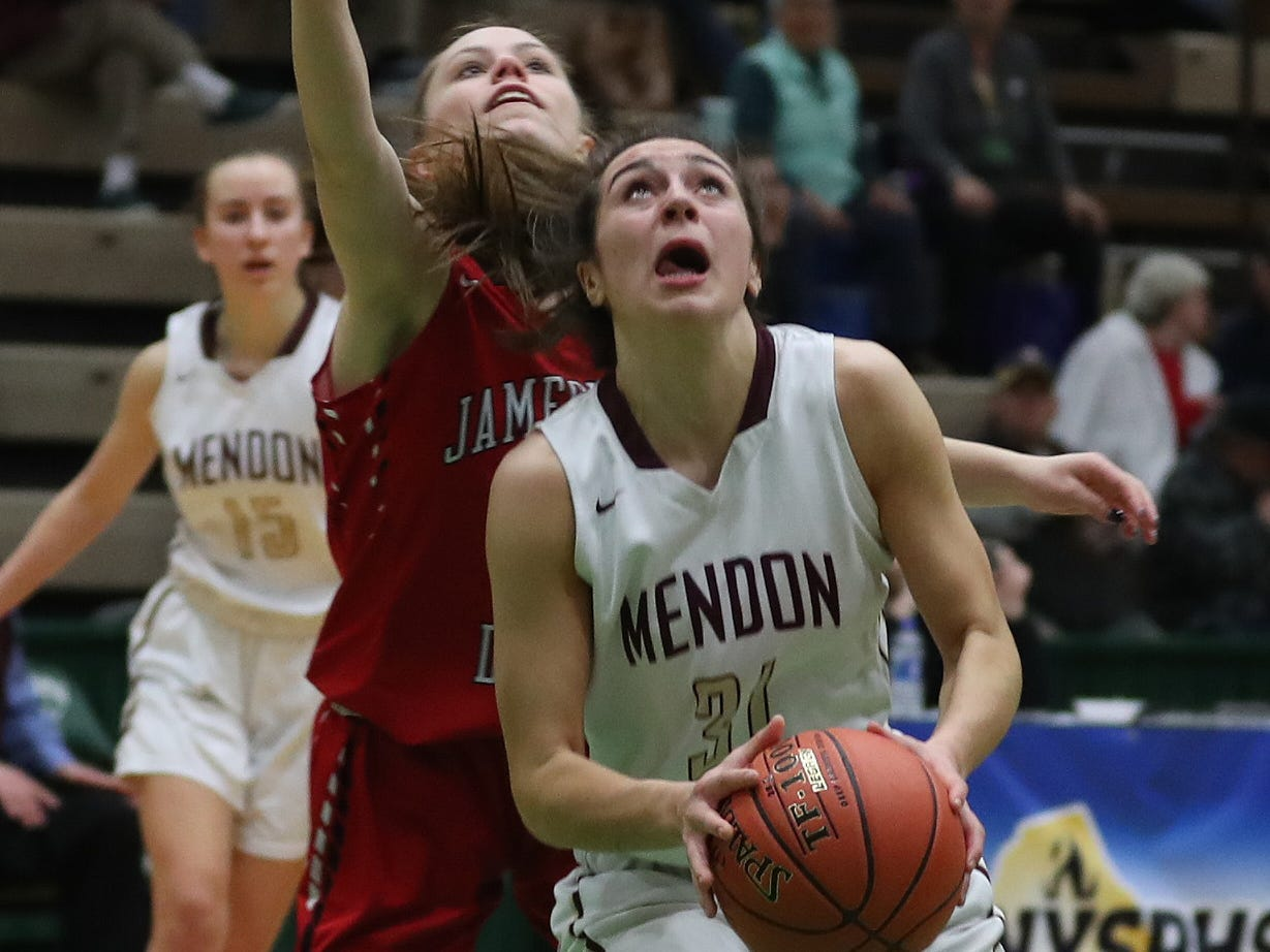 Pittsford Mendon's Katie Bischoping (31) goes up for a shot against Jamesville-DeWitt during the girls Class A state semifinal at Hudson Valley Community College in Troy March 16, 2019.