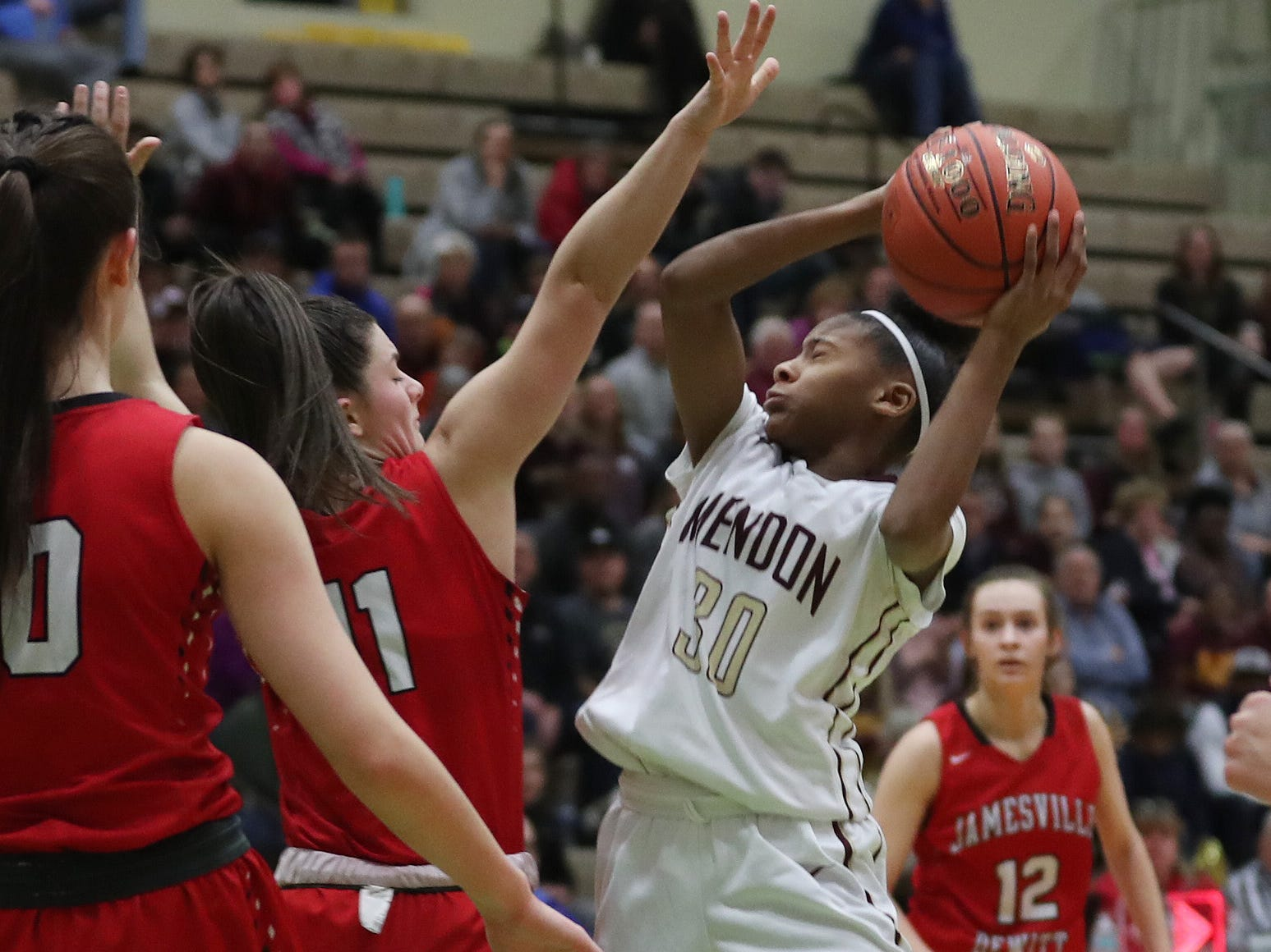 Pittsford Mendon's Anaya Coleman (30) goes up for a shot against Jamesville- DeWitt during the girls Class A state semifinal at Hudson Valley Community College in Troy March 16, 2019.