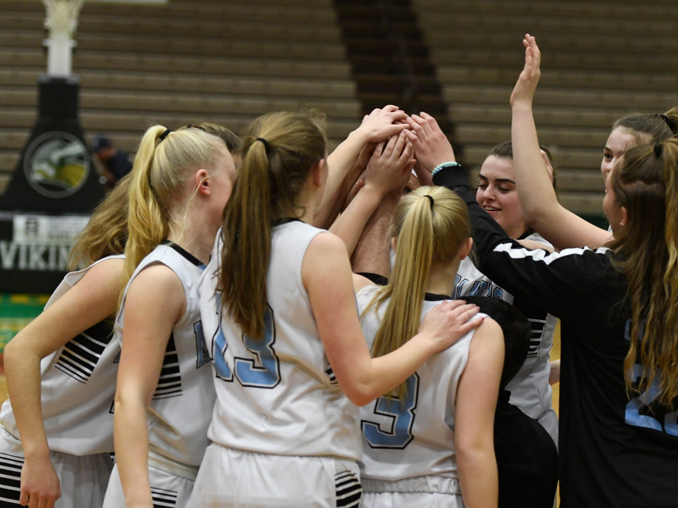 Midlakes girls basketball players rally prior to the start of their Class B State Semifinal against Canton at Hudson Valley Community College in Troy, N.Y. on Friday, Mar. 15, 2019.