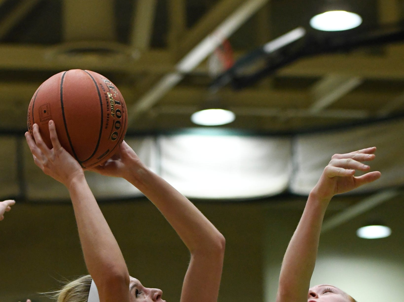Midlakes's Sydney Passalacqua takes a shot over Canton's Hailee Duvall during their Class B State Semifinal at Hudson Valley Community College in Troy, N.Y. on Friday, Mar. 15, 2019.