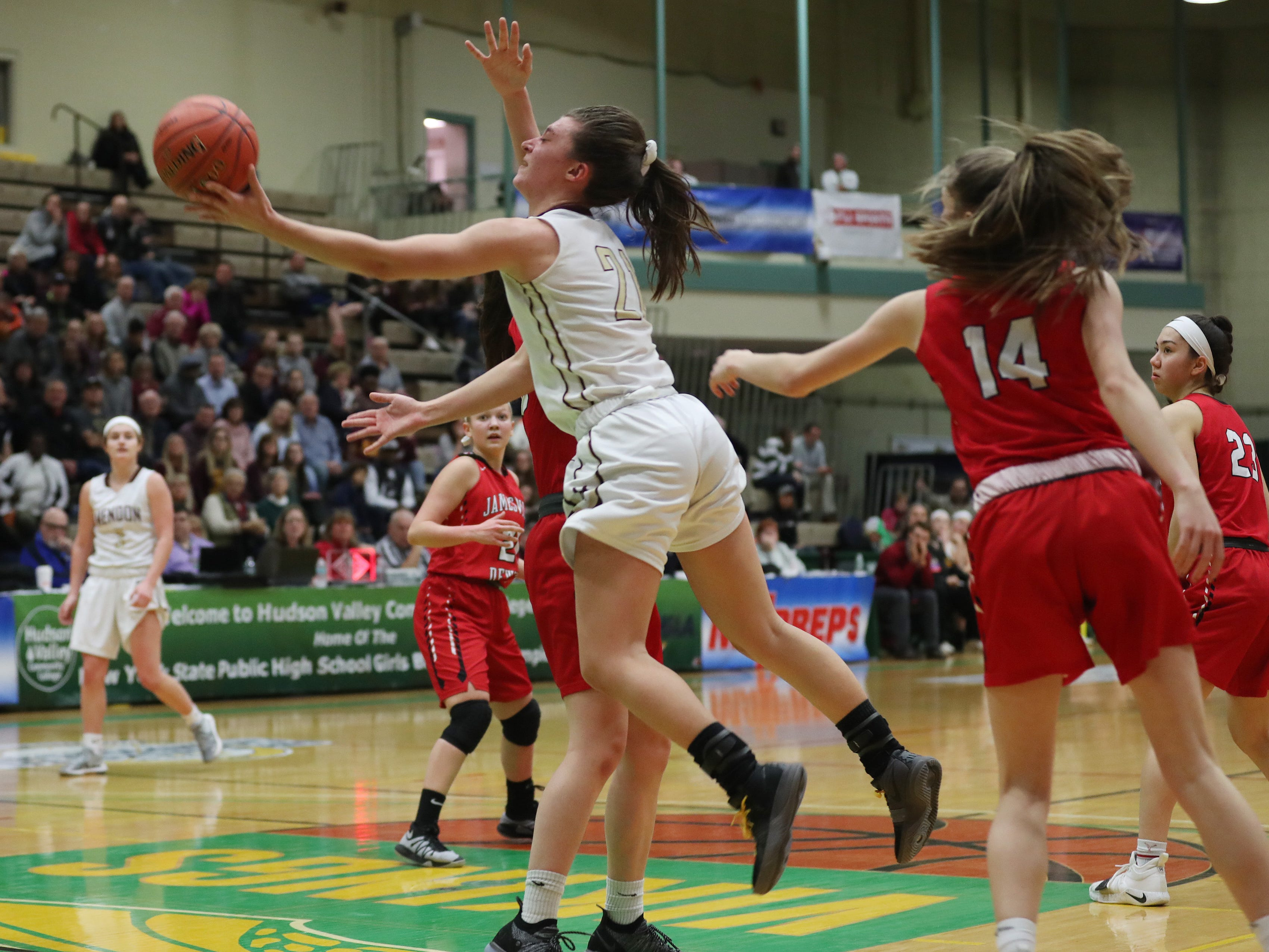 Pittsford Mendon's Alana Fursman (21) drives to the basket against Jamesville-DeWitt during the girls Class A state semifinal at Hudson Valley Community College in Troy March 16, 2019.