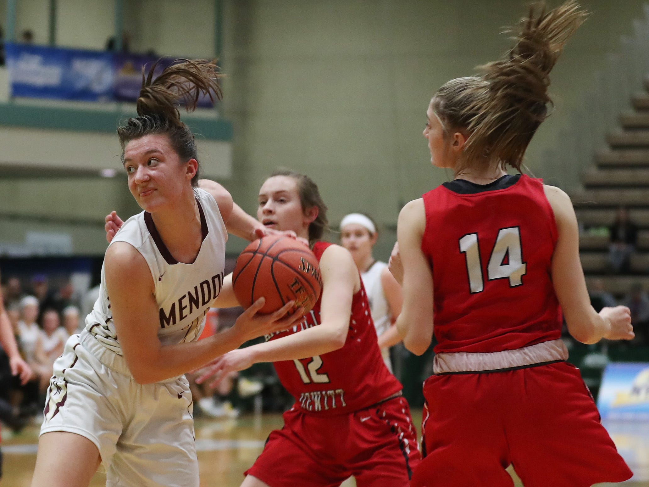 Pittsford Mendon's Alana Fursman (21) moves towards the basket against Jamesville-DeWitt's Sydney Baker (2) during the girls Class A state semifinal at Hudson Valley Community College in Troy March 16, 2019.
