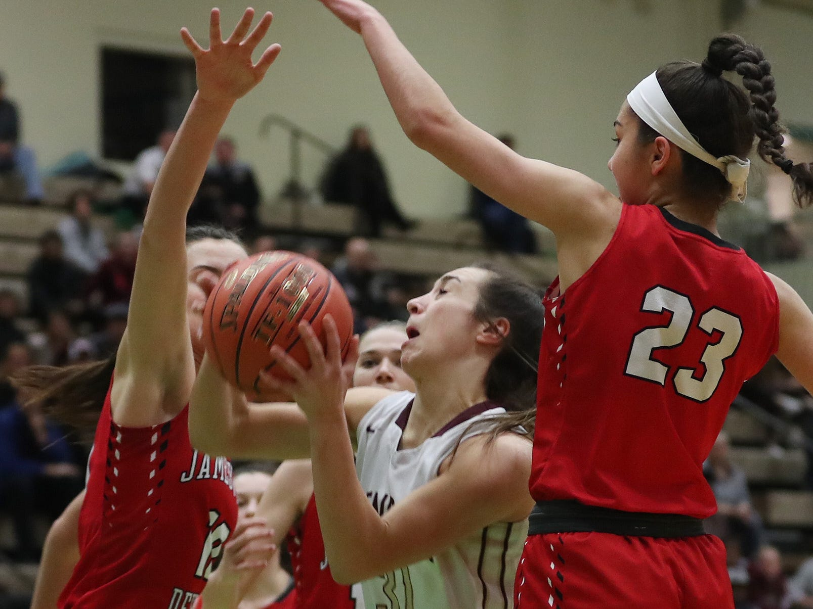 Pittsford Mendon's Katie Bischoping (31) tries to drive to the basket against Jamesville-DeWitt's Sydney Baker (2) during the girls Class A state semifinal at Hudson Valley Community College in Troy March 16, 2019.