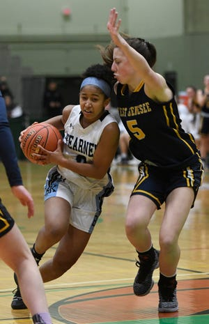 Bishop Kearney's Marianna Freeman drives past West Genesee's Catie Cunningham during their Class AA semifinal at Hudson Valley Community College on March 16, 2019 in Troy.