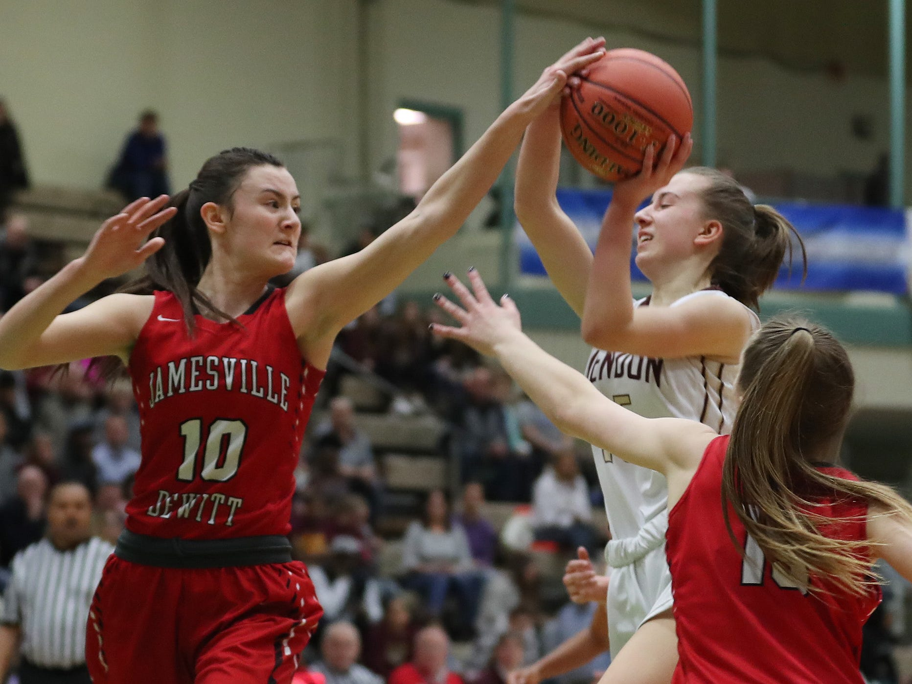 Pittsford Mendon's Danielle Strauf (15) gets pressured by Jamesville-DeWitt's Andrea Sumida (10) during the girls Class A state semifinal at Hudson Valley Community College in Troy March 16, 2019.