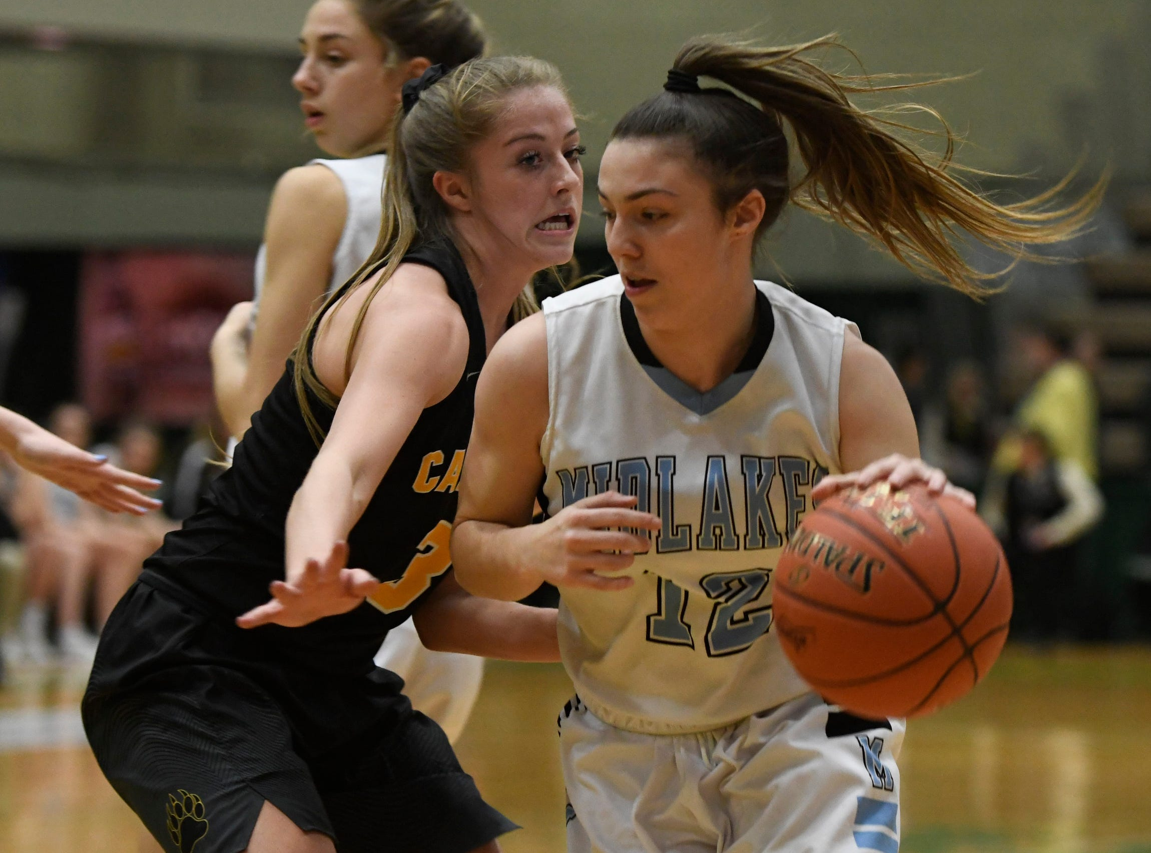 Midlakes's Alaina Forbes dribbles the ball past Canton's Katie Chisholm during their Class B State Semifinal at Hudson Valley Community College in Troy, N.Y. on Friday, Mar. 15, 2019.