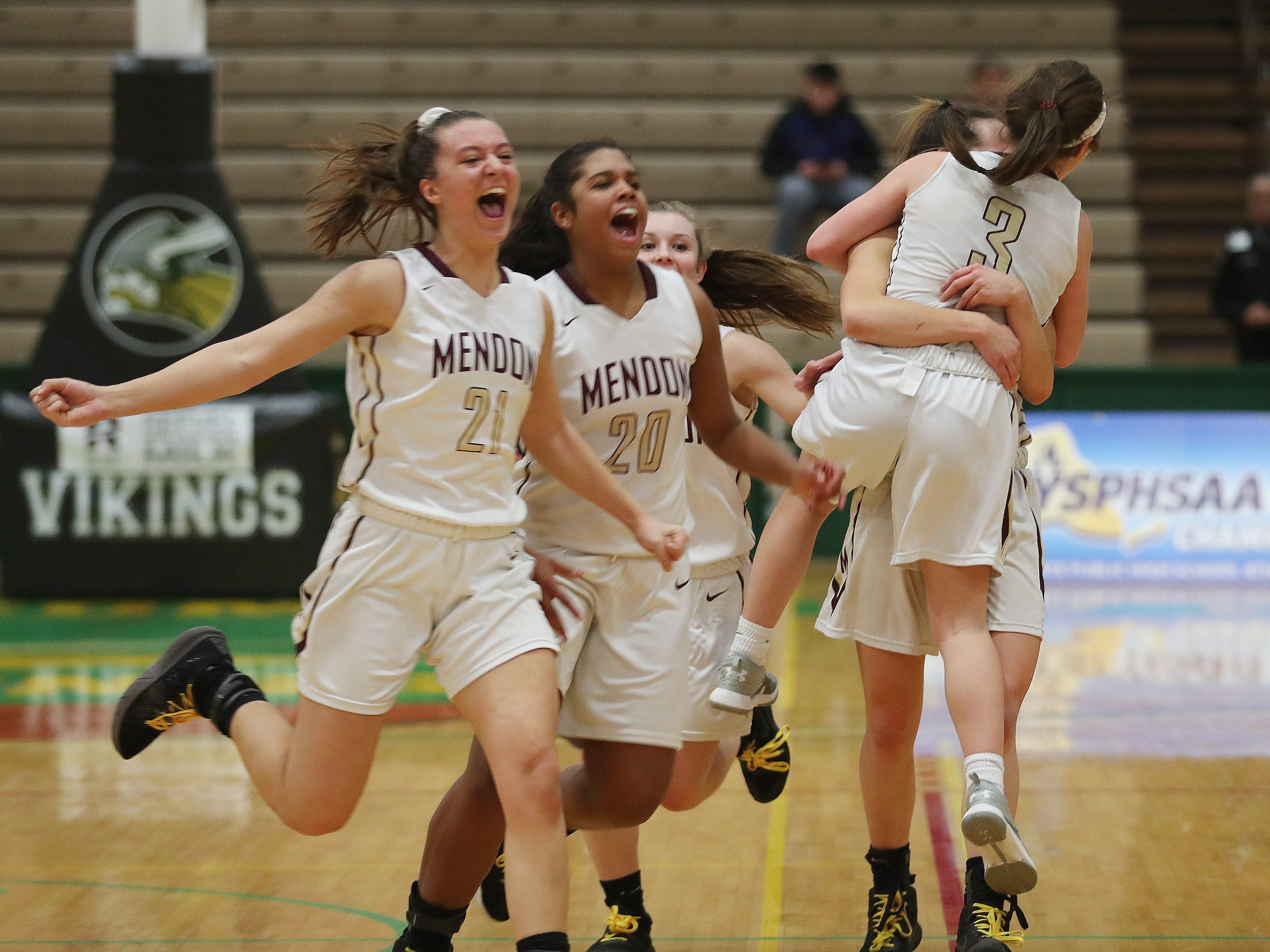 Pittsford Mendon players celebrate their victory over  Jamesville-DeWitt in the girls Class A state semifinal at Hudson Valley Community College in Troy March 16, 2019. Mendon won 44-32 and plays Seton Catholic Central in the final.
