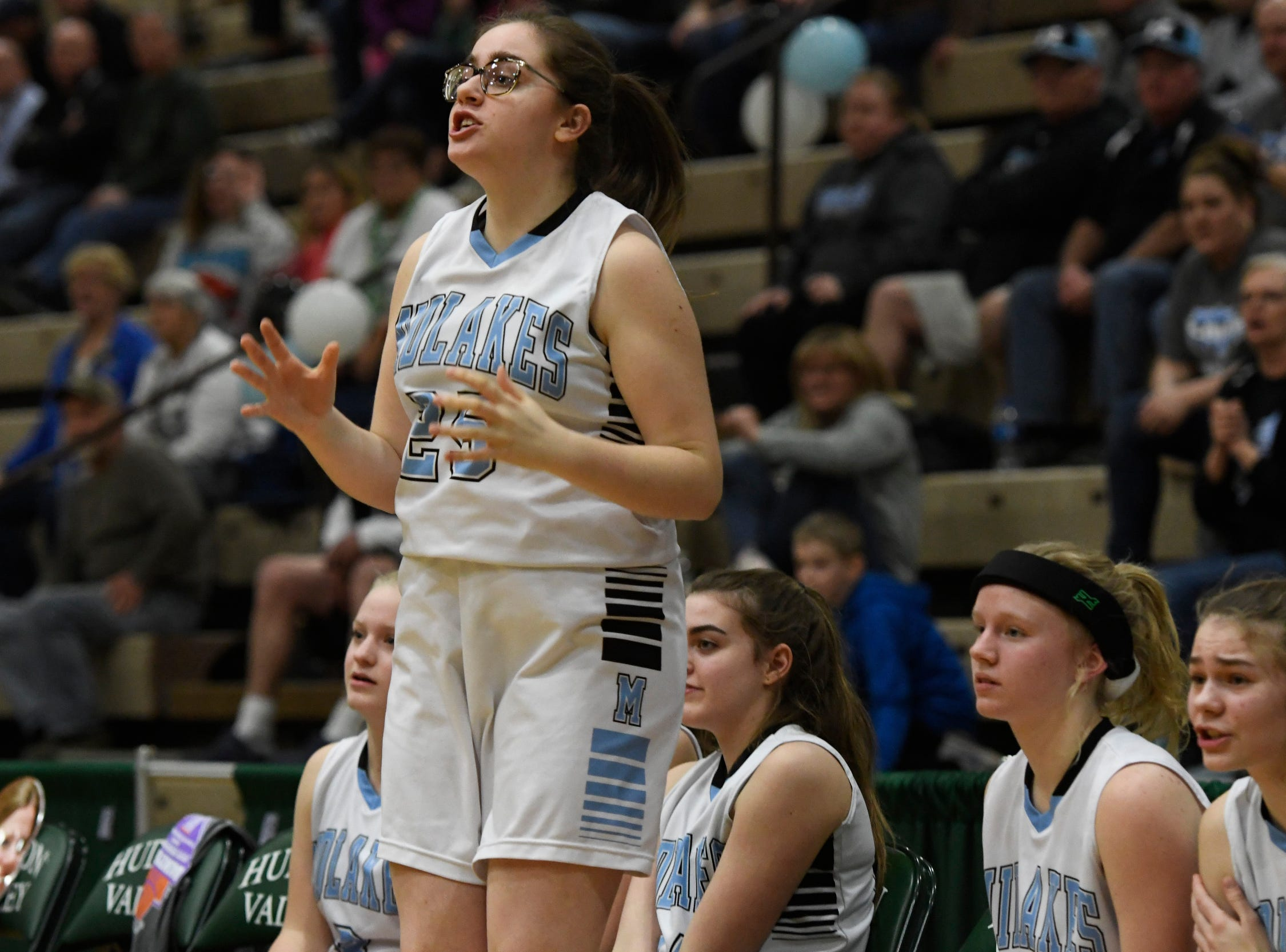 Midlakes's Marina Markovic jumps off the bench when a scoring opportunity presents itself to her teammates on the court during their Class B State Semifinal against Canton at Hudson Valley Community College in Troy, N.Y. on Friday, Mar. 15, 2019.