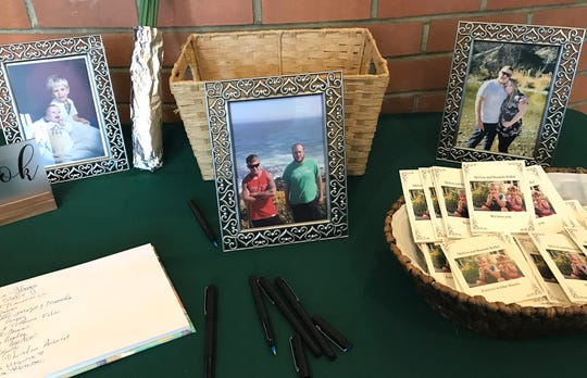 Photos and a guest book sit on a table at St. Joseph Roman Catholic Church in Redding on Saturday where a memorial service was held for brothers Melvin and Bennett Riffel who were among the passengers killed in the crash of Ethiopian Airlines Flight 302.