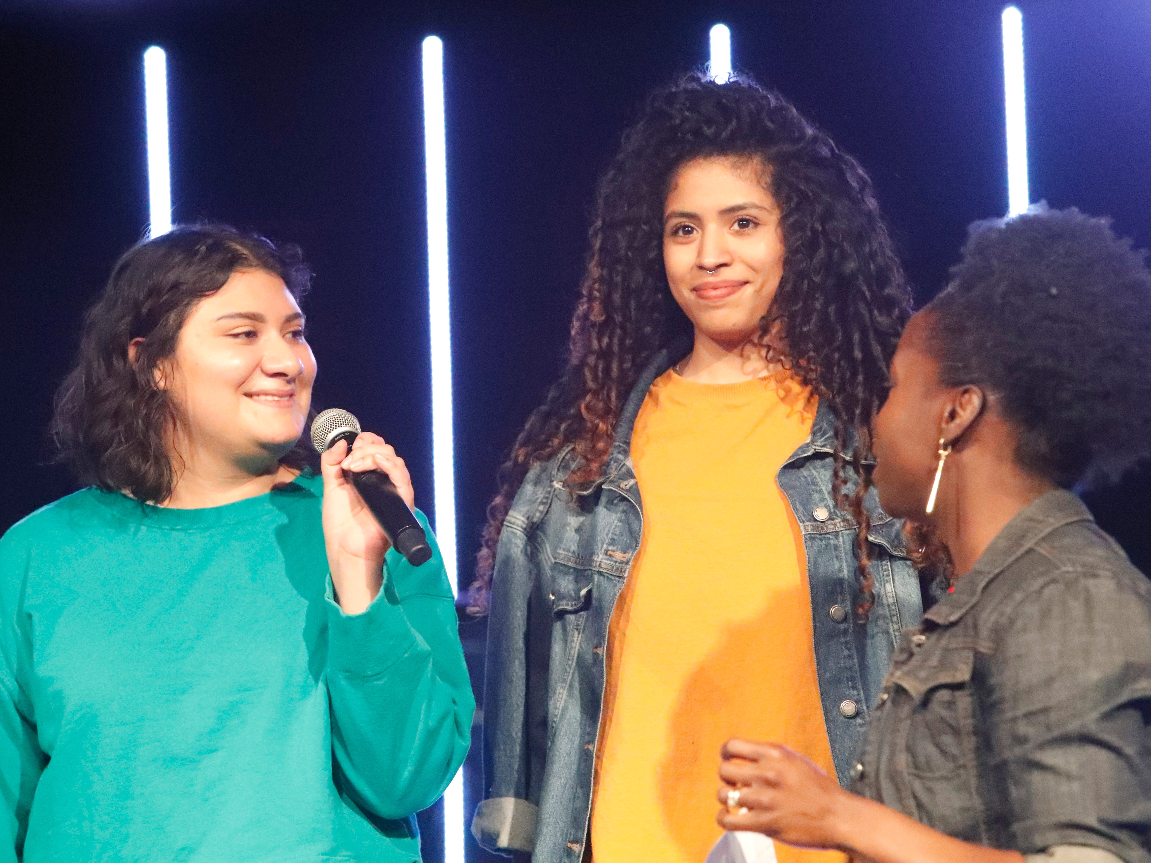 International students from Bethel Church's School of Supernatural Ministry present the Concert of the Nations on Thursday, March 14, 2019, in Redding. Pictured are Cindy Garcia Gomez, left to right, Karla Rodriguez Villar (Mexico) and emcee Jamila Olufemi Page.