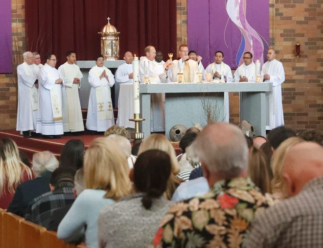 Father Michael Ritter of Chico, center, and Deacon Mike Mangas, with chalice, hold a memorial service with other clergy at St. Joseph Roman Catholic Church in Redding in March 2019  where they and about 1,000 people remembered Melvin and Bennett Riffel. The brothers died in the crash of Ethiopian Airlines Flight 302.