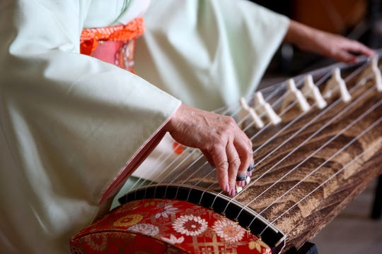Masumi Timson plays the koto during Cherry Blossom Day festivities at the Oregon State Capitol in Salem on March 16, 2019.