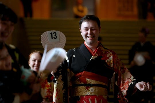 Devin Dondero, of Tacoma, Wash., models his outfit during the kimono contest, part of Cherry Blossom Day festivities at the Oregon State Capitol in Salem on March 16, 2019.