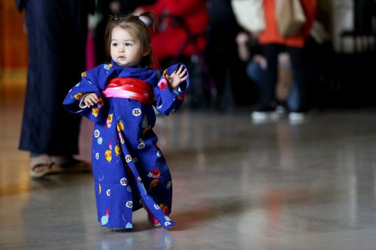 Ava Duimstra, 15 months, of Portland, models her outfit during the kimono contest, part of Cherry Blossom Day festivities at the Oregon State Capitol in Salem on March 16, 2019.