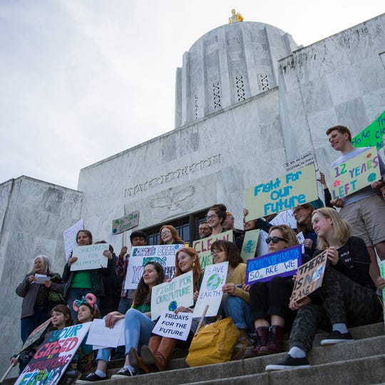 Around 20 students and supporters rally  for climate change, in support of the Global Climate Strike and National Youth Climate Strike, at the Oregon State Capitol Building on March 15, 2019.