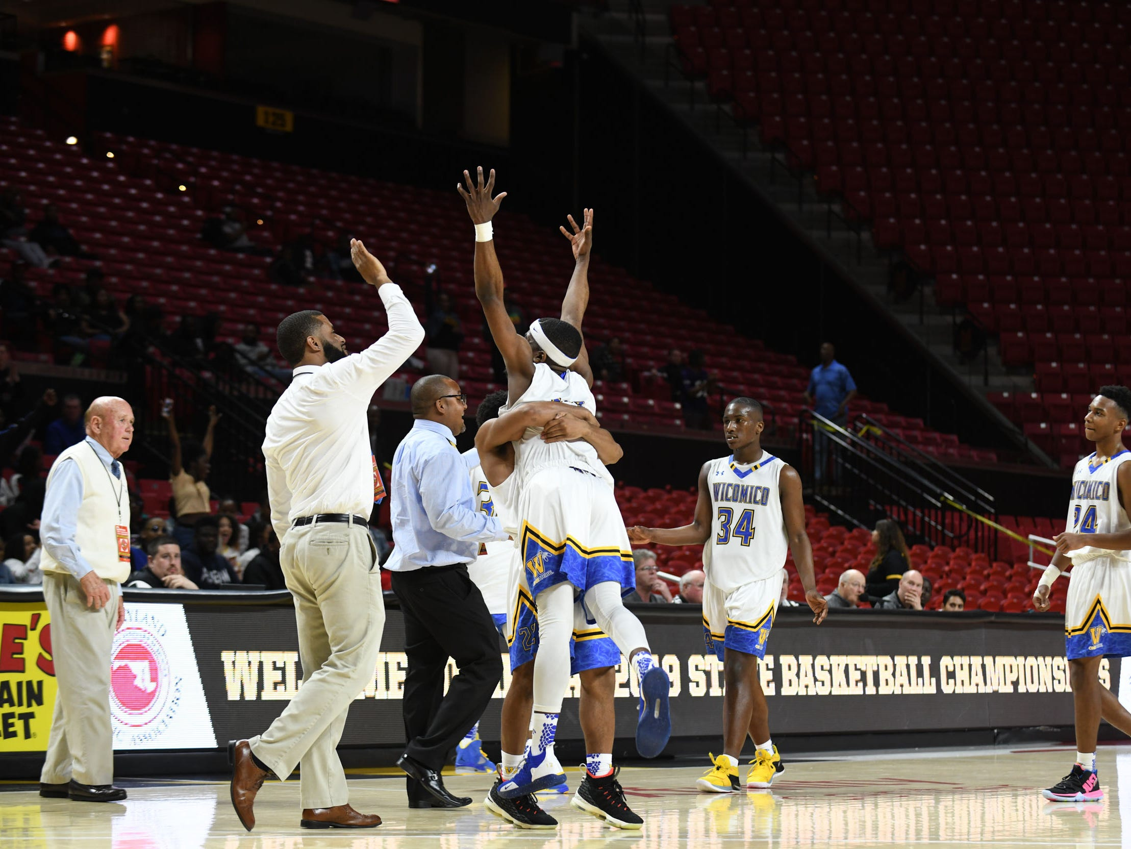 Wi-Hi celebrates after extending the lead against Oakdale during the MPSSAA semifinals at the Xfinity Center in College Park, Md. Friday, March 15, 2019.