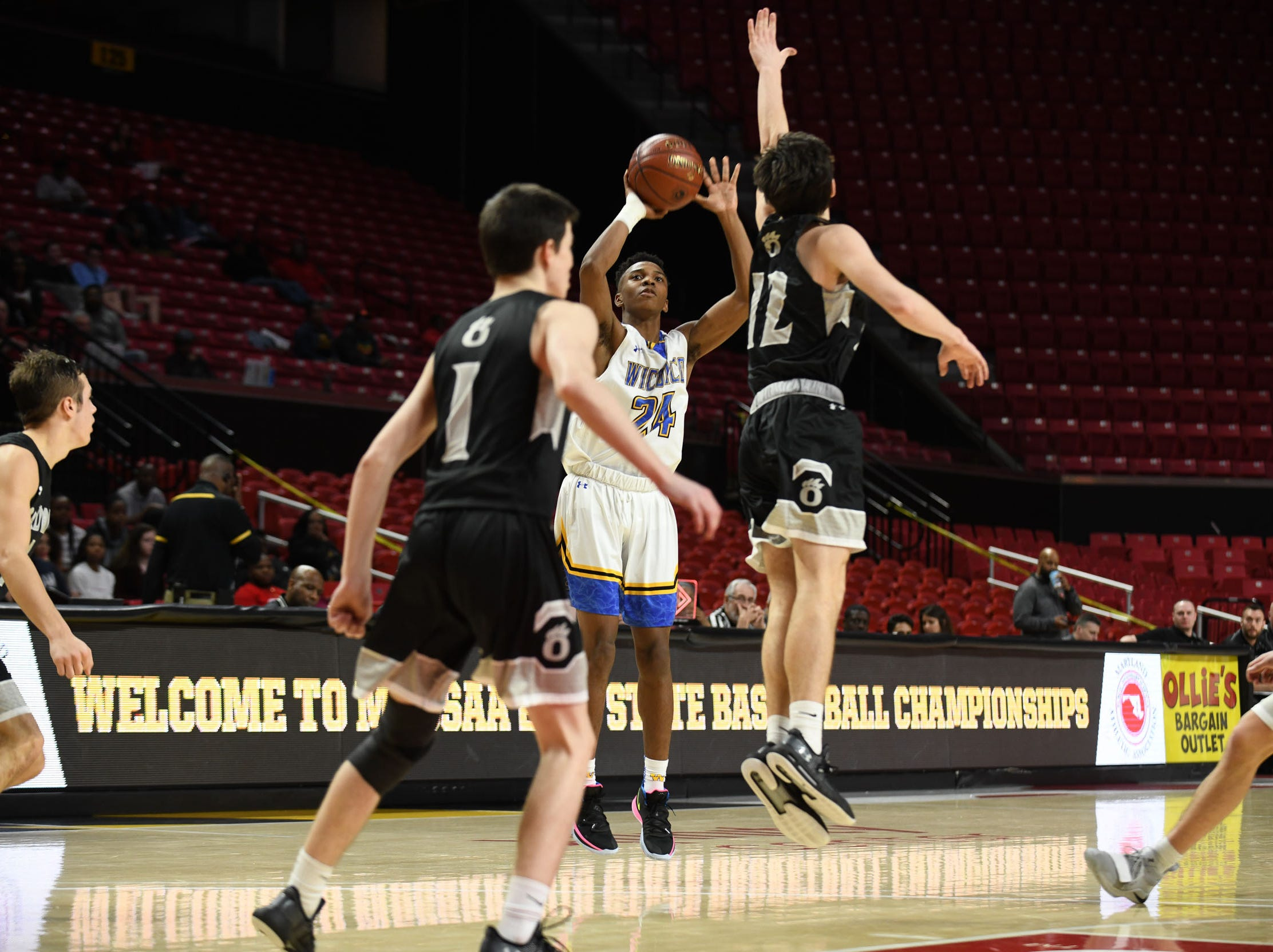 Wi-Hi's Jaden Baker with the shot against Oakdale during the MPSSAA semifinals at the Xfinity Center in College Park, Md. Friday, March 15, 2019.