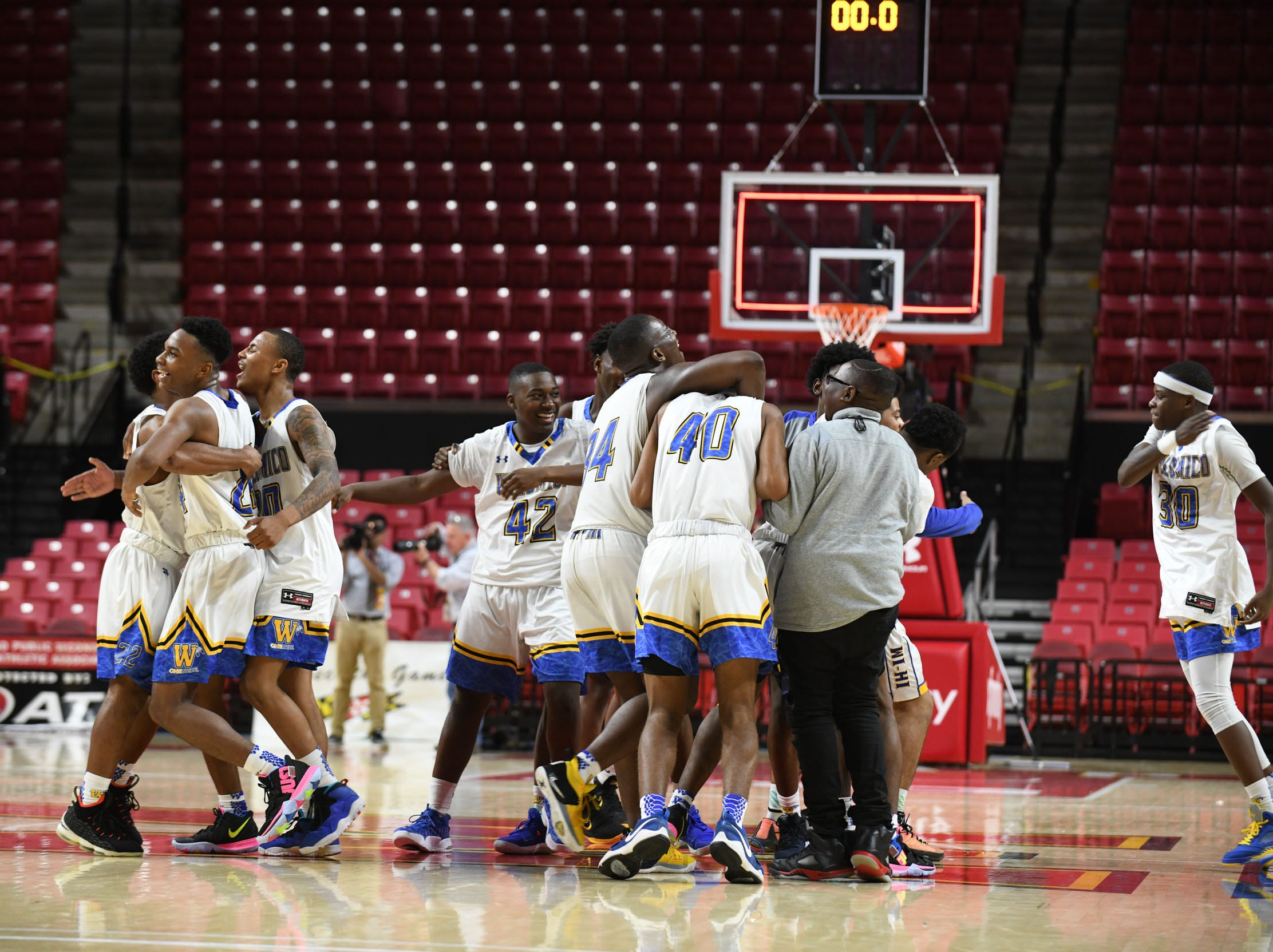 Wi-Hi celebrates after winning against Oakdale during the MPSSAA semifinals at the Xfinity Center in College Park, Md. Friday, March 15, 2019.