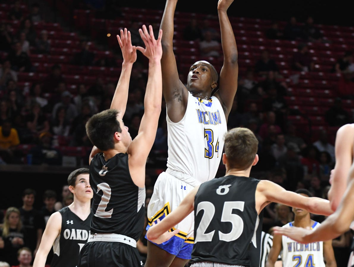 Wi-Hi's Jayson Handy with a jumper against Oakdale during the MPSSAA semifinals at the Xfinity Center in College Park, Md. Friday, March 15, 2019.