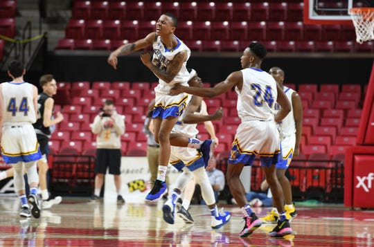 Wi-Hi's Dorian Stevens celebrates after connecting on a 3-point shot to get the lead back against Oakdale during the MPSSAA semifinals at the Xfinity Center in College Park, Md.