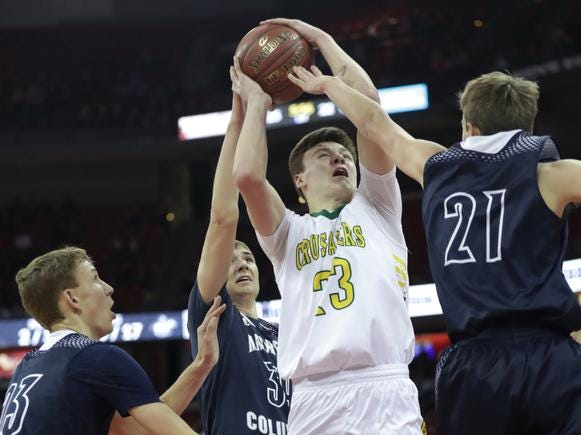 Sheboygan Area Lutheran High School's #23 Jacob Ognacevic against Columbus Catholic High School's #21 Tom Nystrom during their WIAA Division 5 boys basketball state championship game on Saturday, March 15, 2019, at the Kohl Center in Madison, Wis. 