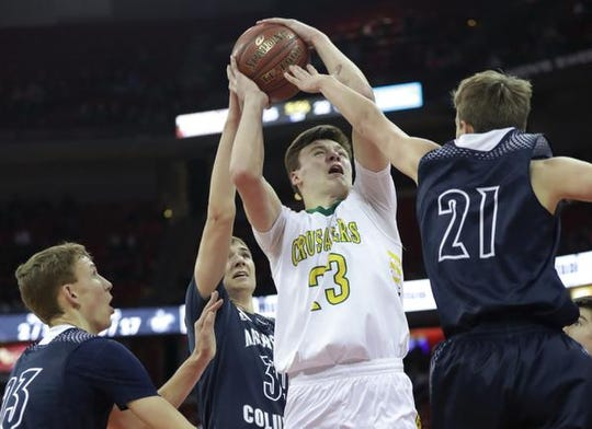 Sheboygan Lutheran's Jacob Ognacevic goes up for a shot against Columbus Catholic's Tom Nystrom during their WIAA Division 5 boys basketball state championship game March 15 at the Kohl Center in Madison.