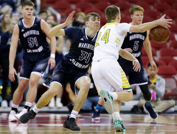 Columbus Catholic High School's Ethan Meece (34) defends Sheboygan Area Lutheran High School's Casey Verhagen (24) in the Division 5 boys basketball state championship game on Saturday, March 16, 2019, at the Kohl Center in Madison, Wis. The Crusaders beat Columbus Catholic, 74-61.