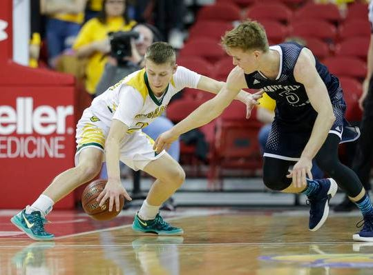 Sheboygan Area Lutheran High School's Casey Verhagen (24) steals the ball from Columbus Catholic High School's Noah Taylor (5) during the WIAA Division 5 boys basketball state championship game at the Kohl Center Saturday, March 16, 2019, in Madison, Wis. Joshua Clark/USA TODAY NETWORK-Wisconsin