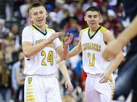 Sheboygan Area Lutheran High School's Casey Verhagen (24) reacts after a foul against Columbus Catholic High School in the Division 5 boys basketball state championship game on Saturday, March 16, 2019, at the Kohl Center in Madison, Wis. The Crusaders beat Columbus Catholic High School, 74-61.