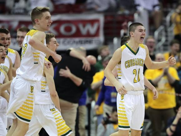 Sheboygan Area Lutheran High School players react follwing their win over Columbus Catholic High School during their WIAA Division 5 boys basketball state championship game on Saturday, March 15, 2019, at the Kohl Center in Madison, Wis. Sheboygan defeated Columbus 74 to 61.