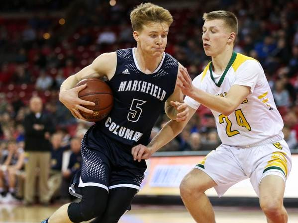 Columbus Catholic High School's Noah Taylor (5) drives past Sheboygan Area Lutheran High School's Casey Verhagen (24) in the Division 5 boys basketball state championship game on Saturday, March 16, 2019, at the Kohl Center in Madison, Wis. The Crusaders beat Columbus Catholic, 74-61.