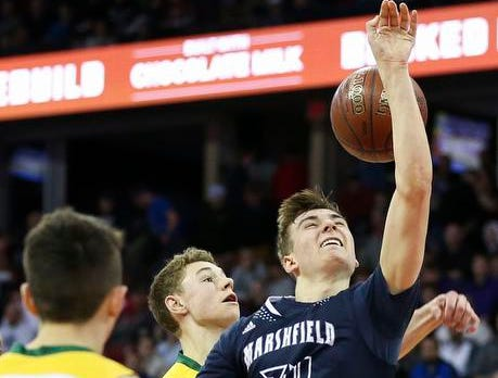 Columbus Catholic High School's Ethan Meece (34) loses the ball on his way to the basket against Sheboygan Area Lutheran High School in the Division 5 boys basketball state championship game on Saturday, March 16, 2019, at the Kohl Center in Madison, Wis. The Crusaders beat Columbus Catholic, 74-61.
