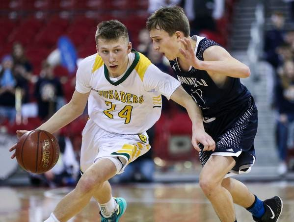 Sheboygan Area Lutheran High School's Casey Verhagen (24) drives past Columbus Catholic High School's Tom Nystrom (21) in the Division 5 boys basketball state championship game on Saturday, March 16, 2019, at the Kohl Center in Madison, Wis. The Crusaders beat Columbus Catholic High School, 74-61.