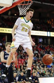 Sheboygan Lutheran's Jacob Ognacevic celebrates after his dunk during Saturday's WIAA Division 5 boys state basketball championship game against Columbus Catholic at the Kohl Center in Madison.