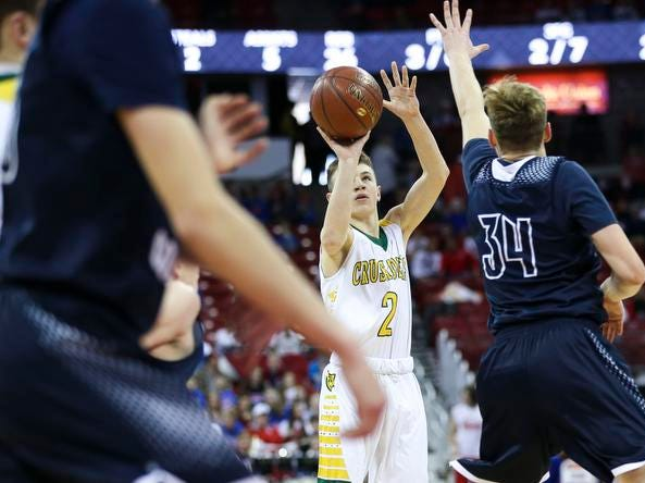 Sheboygan Area Lutheran High School's Robby Michael (2) shoots a 3-pointer against Columbus Catholic High School in the Division 5 boys basketball state championship game on Saturday, March 16, 2019, at the Kohl Center in Madison, Wis. The Crusaders beat Columbus Catholic High School, 74-61.