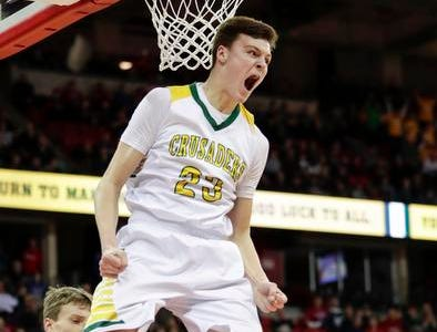 Sheboygan Area Lutheran's Jacob Ognacevic reacts after throwing down a dunk against Marshfield Columbus during the Division 5 title game. Ognacevic was a force in the contest as he scored 35 points and grabbed 19 rebounds.