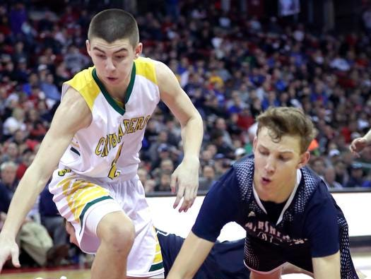 Sheboygan Area Lutheran High School's #21 Jonah Jurss against Columbus Catholic High School's #23 Bryce Fuerlinger during their WIAA Division 5 boys basketball state championship game on Saturday, March 15, 2019, at the Kohl Center in Madison, Wis. Sheboygan defeated Columbus 74 to 61.