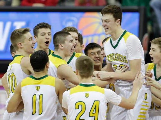 Sheboygan Area Lutheran High School rallies around teammate Jacob Ognacevic (23) after defeating Columbus Catholic High School for the WIAA Division 5 boys basketball state championship at the Kohl Center Saturday, March 16, 2019, in Madison, Wis. Joshua Clark/USA TODAY NETWORK-Wisconsin