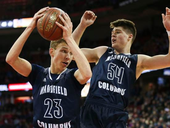 Columbus Catholic High School's Bryce Fuerlinger (23) pulls down a rebound against Sheboygan Area Lutheran High School in the Division 5 boys basketball state championship game on Saturday, March 16, 2019, at the Kohl Center in Madison, Wis. The Crusaders beat Columbus Catholic High School, 74-61.