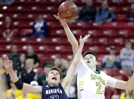 Sheboygan Area Lutheran High School's #23 Jacob Ognacevic against Columbus Catholic High School's #21 Tom Nystrom during their WIAA Division 5 boys basketball state championship game on Saturday, March 15, 2019, at the Kohl Center in Madison, Wis. Sheboygan defeated Columbus 74 to 61.