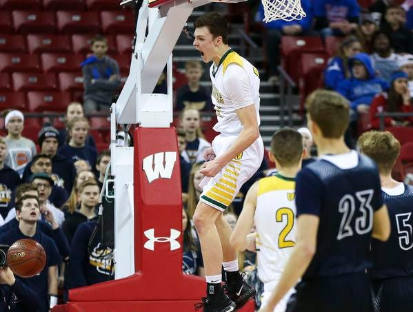 Sheboygan Area Lutheran High School's Jacob Ognacevic (23) reacts after dunking the ball against Columbus Catholic High School in the Division 5 boys basketball state championship game on Saturday, March 16, 2019, at the Kohl Center in Madison, Wis. The Crusaders beat Columbus Catholic, 74-61.