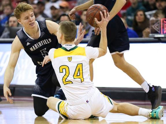 Columbus Catholic High School's Noah Taylor (5) and Sheboygan Area Lutheran High School's Casey Verhagen (24) scramble for a loose ball in the Division 5 boys basketball state championship game on Saturday, March 16, 2019, at the Kohl Center in Madison, Wis. The Crusaders beat Columbus Catholic, 74-61.