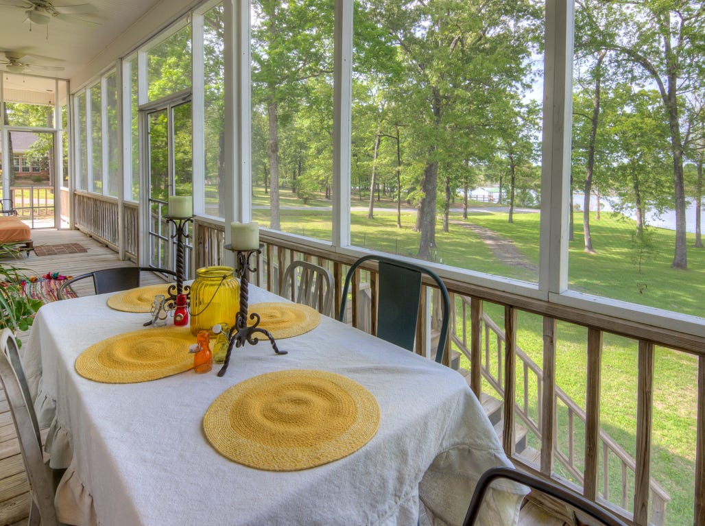 999 Bay Ridge Drive, Benton  Price: $592,500  Details: 4 bedrooms, 3 bathrooms, 682 square feet  Features: Country living on Black Bayou, private farmhouse style home with great sunset views on 2.6 acres, screened patio, boathouse, 1,500 sq.ft. shop, large master suite with great views.   Contact: Mindy Wardlaw 469-3261
