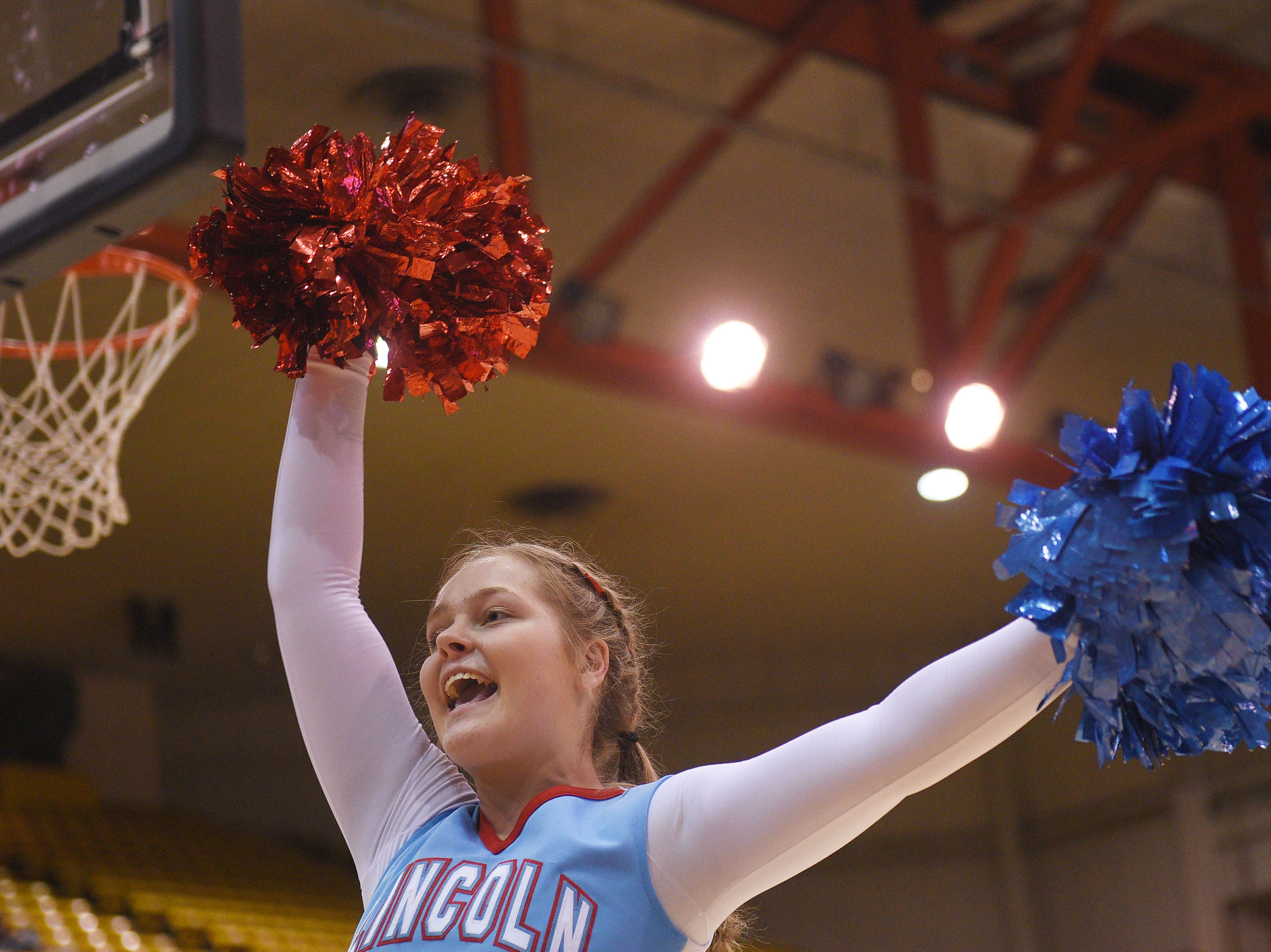 Lincoln cheerleaders get the student section cheering in the fourth period during the game against Harrisburg in the Class AA semifinals Thursday, March 15, in Rapid City.
